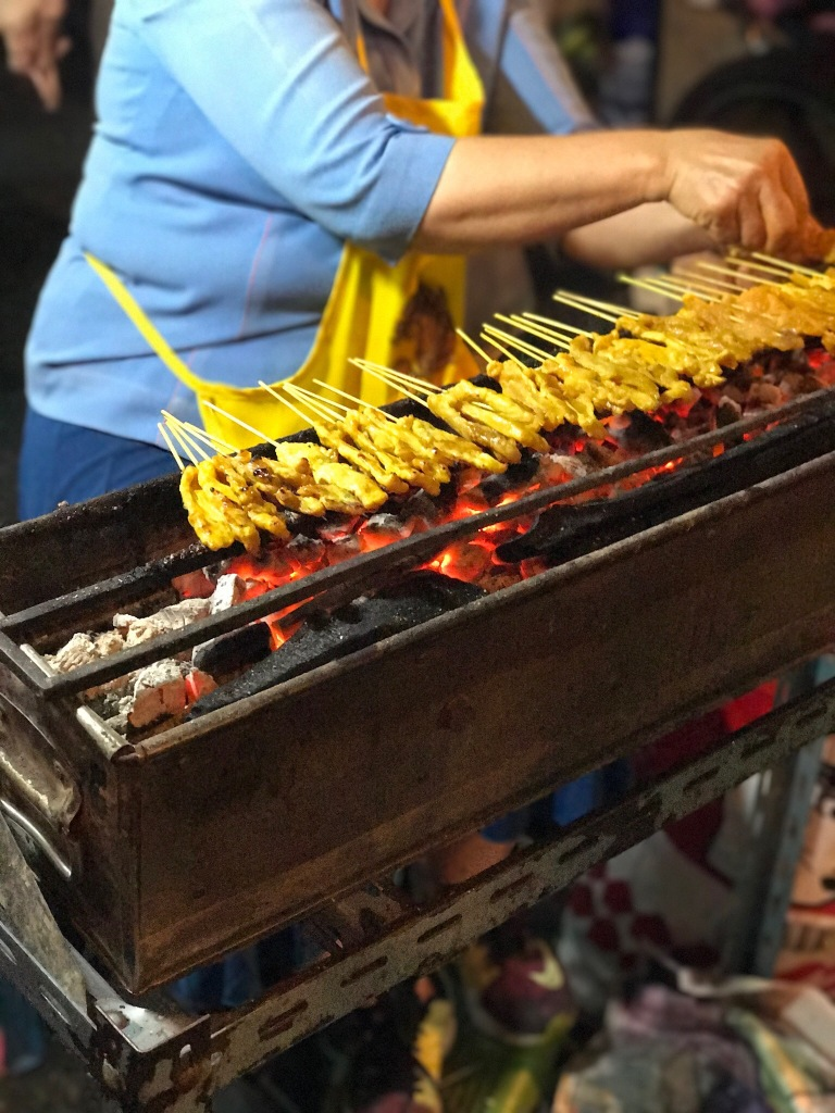 Cooking up some satays @ street food stall in Chinatown