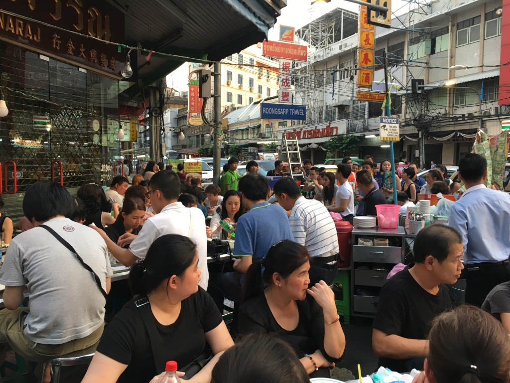 People eating and lining up for a seat at this popular seafood restaurant in Chinatown, Bangkok