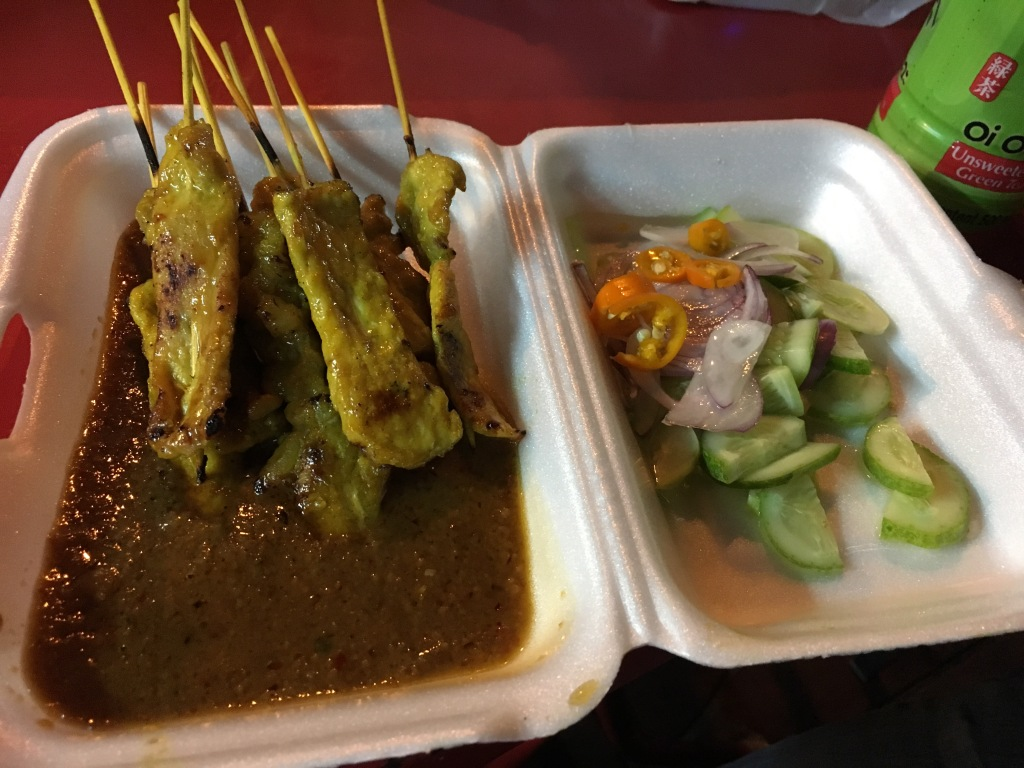Pork Satay served with peanut sauce and vegetables @ street stall in Chinatown