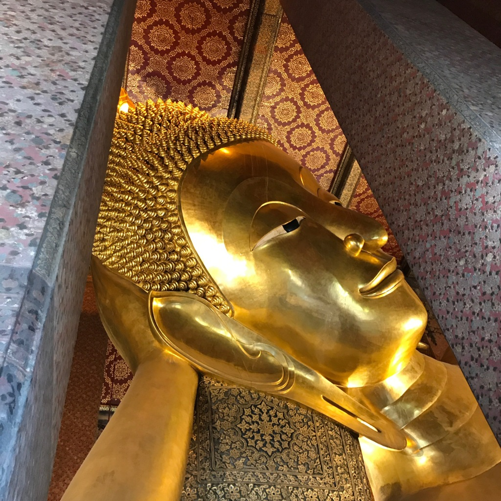 Only able to capture this much of the reclining Buddha statue. It was way too big to capture the whole thing. Photo credit: Aaron. (P.S. As you can tell, I was so hot I gave up on taking pictures here.)
