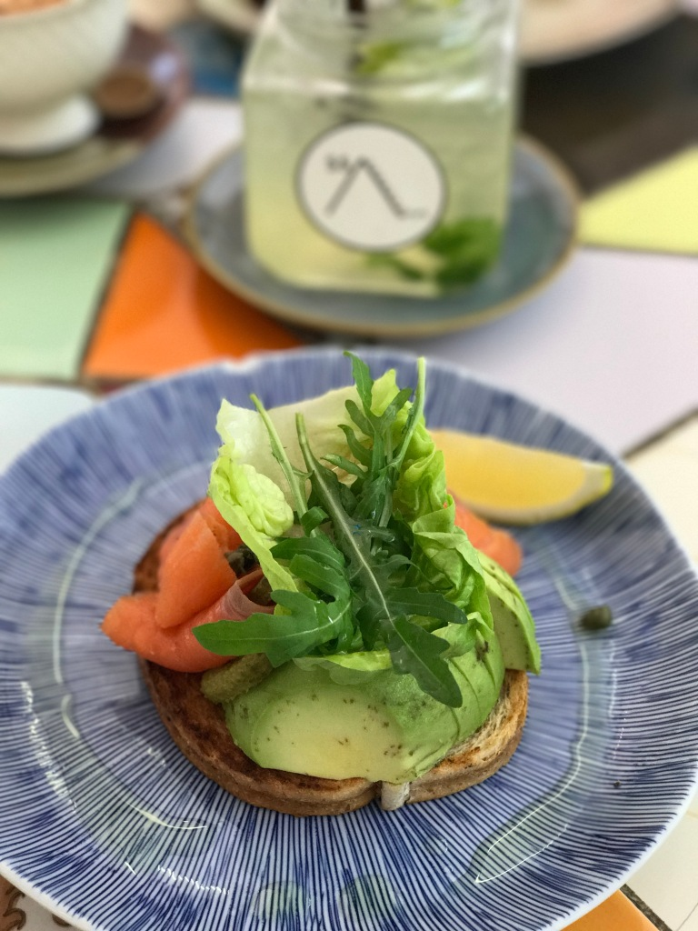 Smoked salmon avocado toast with lemon mint soda in the background @ SS1254372 Cafe. Photo credit: Aaron.